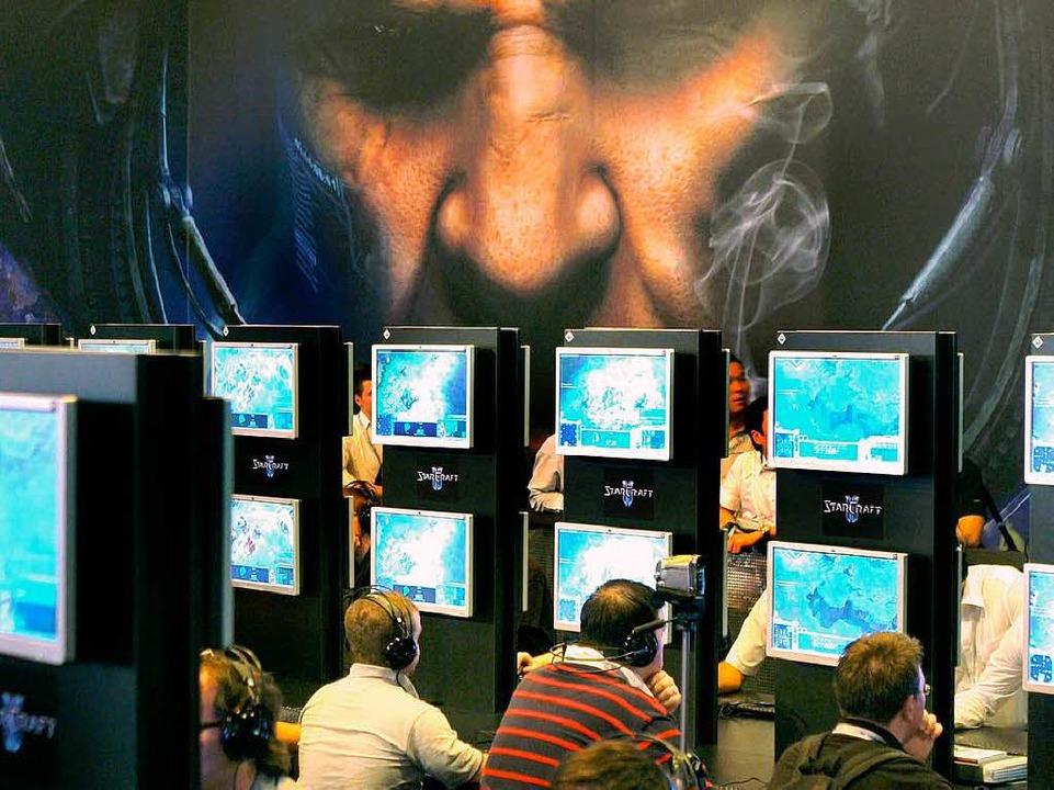 Einer der Anziehungspunkte in Leipzig:... am Stand von Blizzard Entertainment.     Foto: dpa
