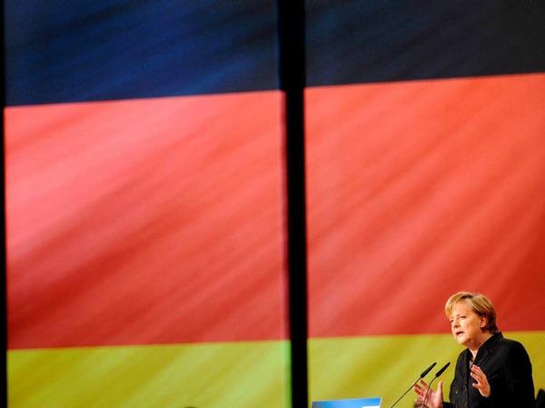 Merkel spricht auf dem Parteitag der CDU in Karlsruhe.
