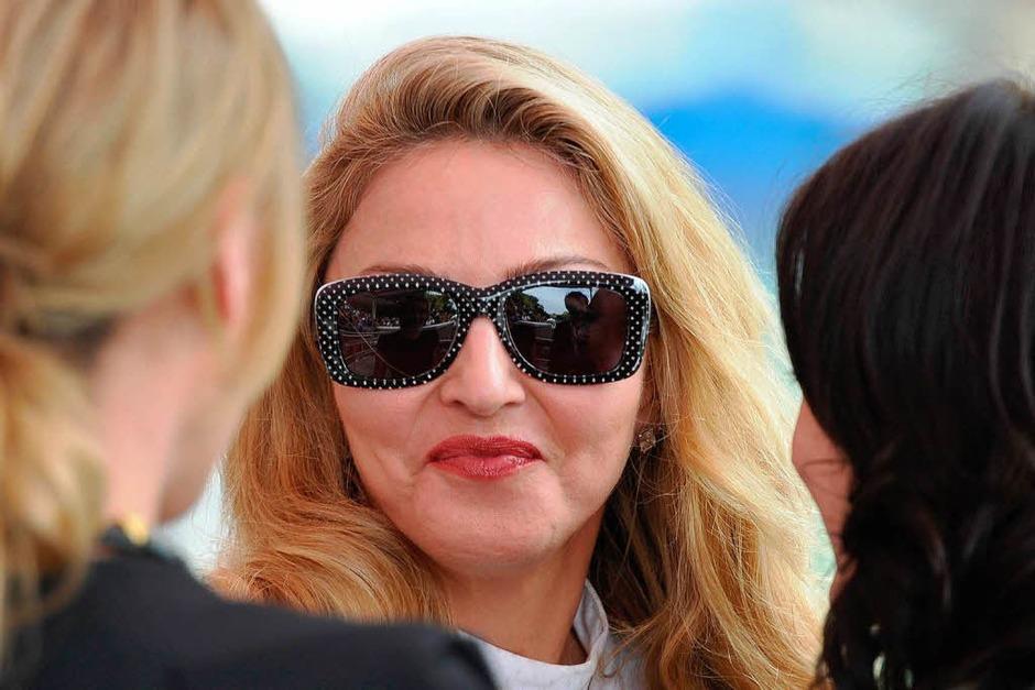 Da fällt das Lächeln schon mal schwer: Madonna frisch gepimpt. (Foto: AFP)
