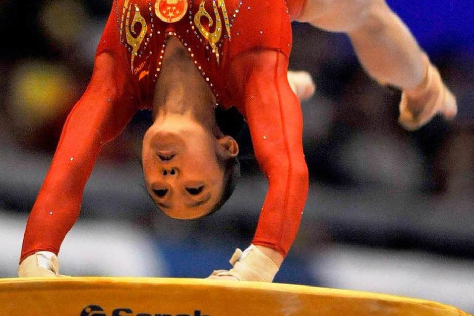 Huang Qiushuang (China) beim Sprung (Foto: dpa)