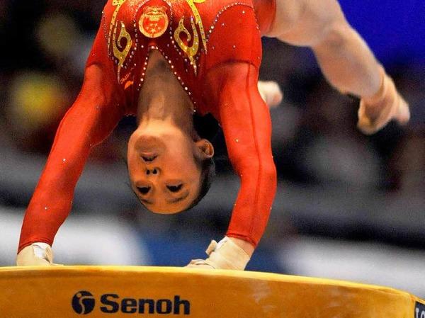 Huang Qiushuang (China) beim Sprung