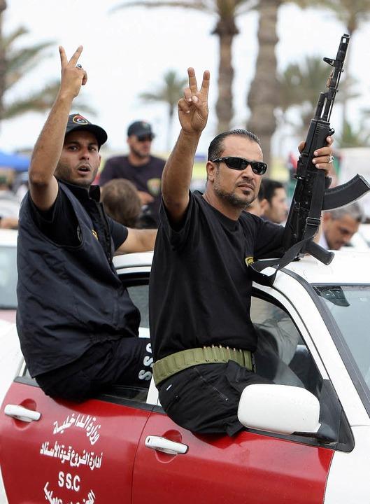 Milizionäre bei einer Parade in der libyschen Hauptstadt Tripolis     Foto: dpa