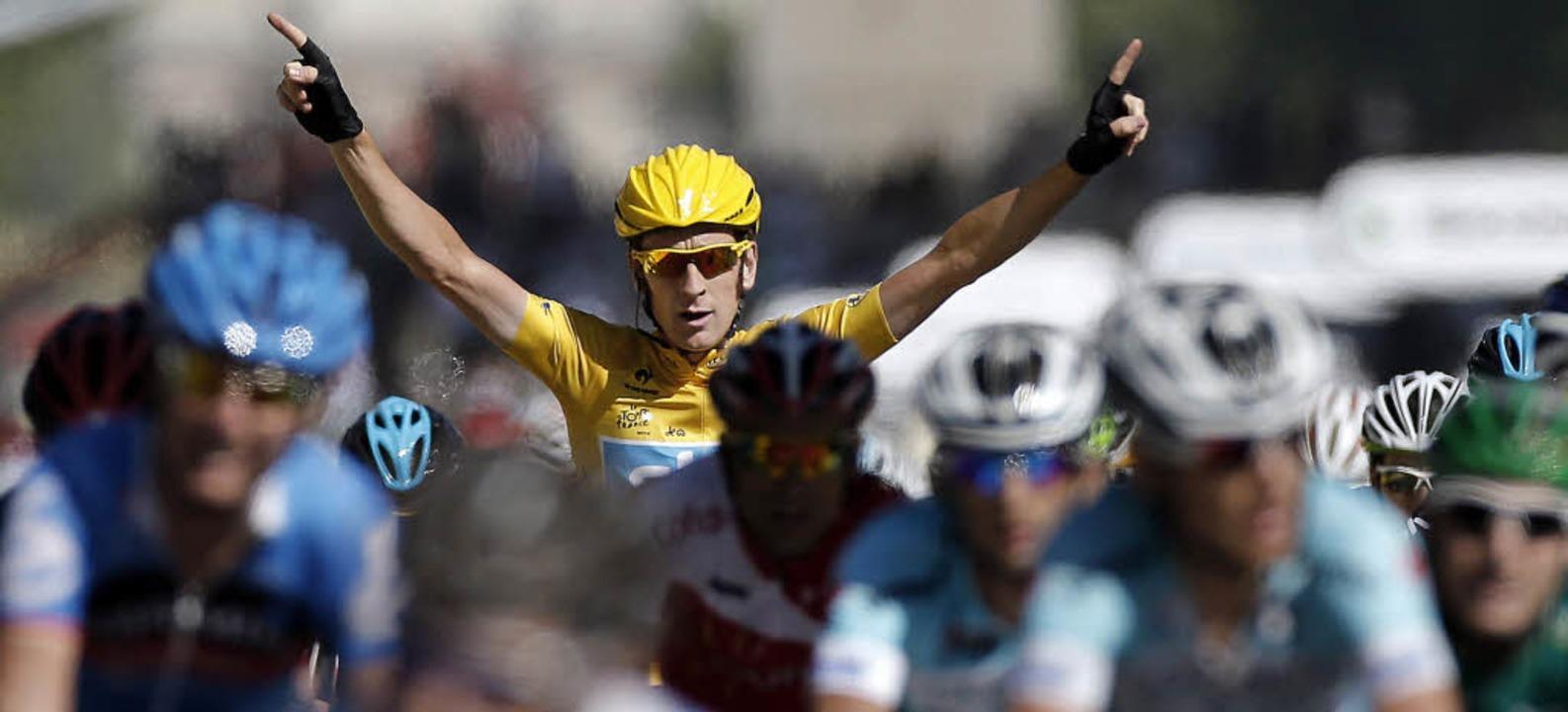 Bradley Wiggins, der Mann in Gelb, rag...er diesjährigen Tour de France heraus.  | Foto: dapd