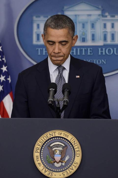 Präsident Obama zeigte sich zutiefst betroffen.  | Foto: dpa