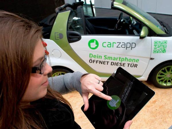 Wem der Autoschlüssel zu altmodisch ist: Mit Tablet oder Smartphone lassen sich die Türen der Teilautos ebenfalls öffnen.