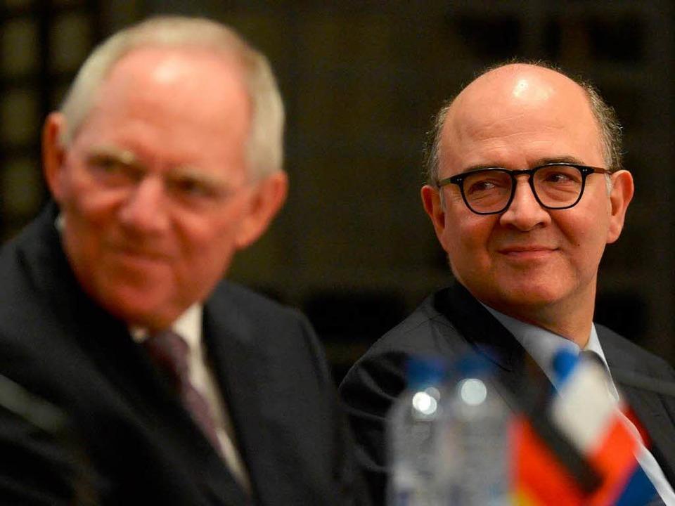 Schäuble (l.) und Moscovici in Straßburg   | Foto: dpa
