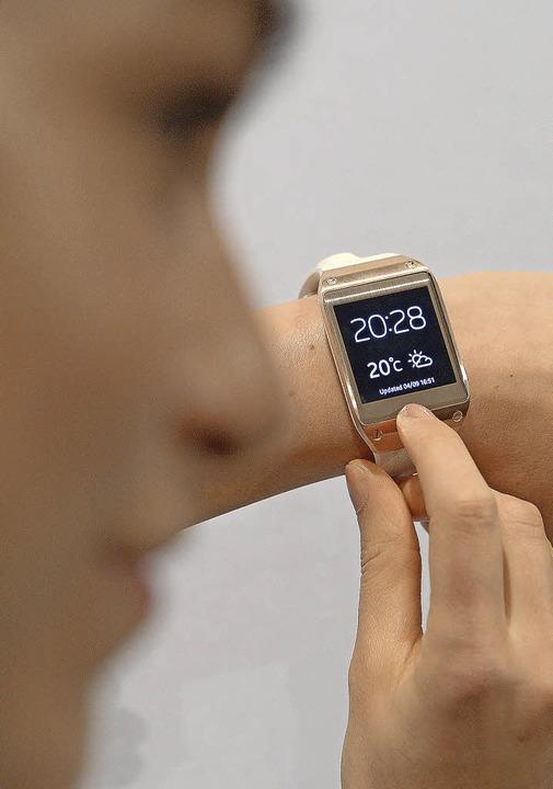 Samsungs Smartwatch halten  Produktpiraten für einen Flop.  | Foto: dpa