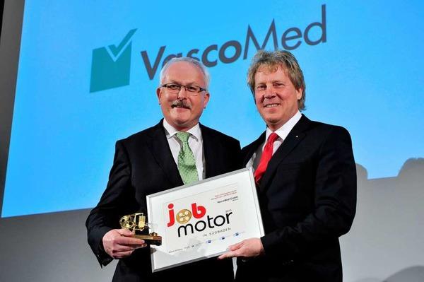 Preisverleihung des Jobmotor 2013 in der Meckelhalle der Sparkasse Freiburg-Nördlicher Breisgau.Dr. Wolfgang Geistert (VasoMed) und Laudator Dietmar Kühne (IHK Hochrhein-Bodensee)