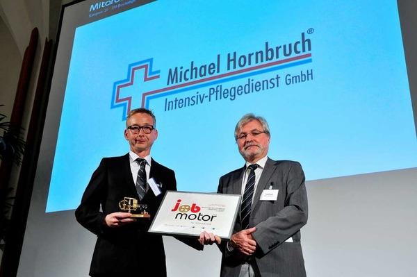 Preisverleihung des Jobmotor 2013 in der Meckelhalle der Sparkasse Freiburg-Nördlicher Breisgau. Michael Hornbruch (Hornbruch Pflegedienst gundelfingen) und Laudator Thomas Hauser (BZ-Chefredakteur)
