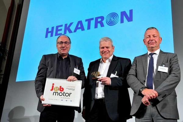 Preisverleihung des Jobmotor 2013 in der Meckelhalle der Sparkasse Freiburg-Nördlicher Breisgau. Peter Ohmberger und Michael Roth (beide Hekatron Sulzburg) und Laudator Christoph Münzer (Geschäftsführer WVIB Freiburg)