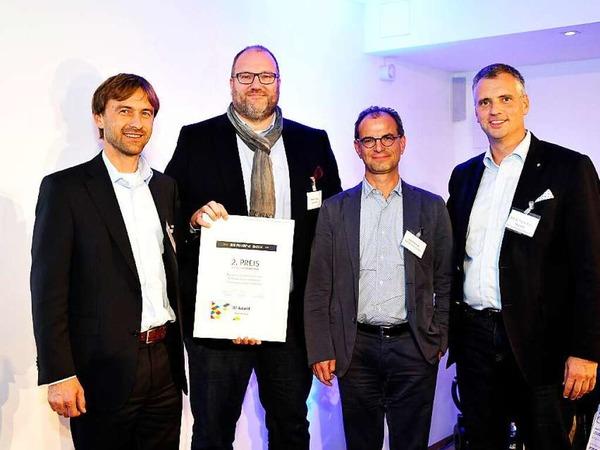 2.Platz Print & Online an Christian Haberberg, Andreas Stauss (beide Stauss Immobilien) und Axel Münchrath - Die Werbeschmiede, hier mit Laudator Thomas Breyer-Mayländer