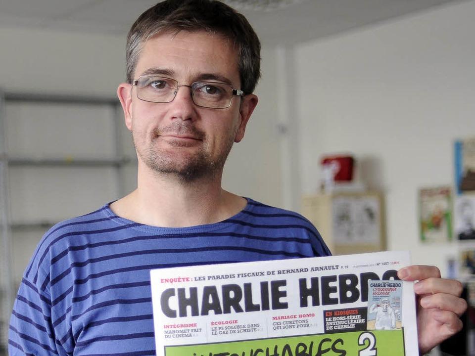 Charb mit dem Satireblatt     Foto: dapd