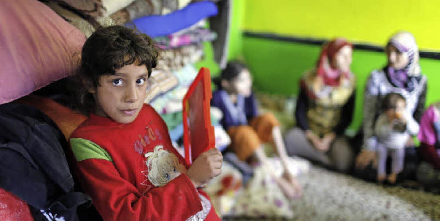 Früher lebte dieses Kind im syrischen ...unterkunft in Gaziantep in der Türkei.    Foto: dpa