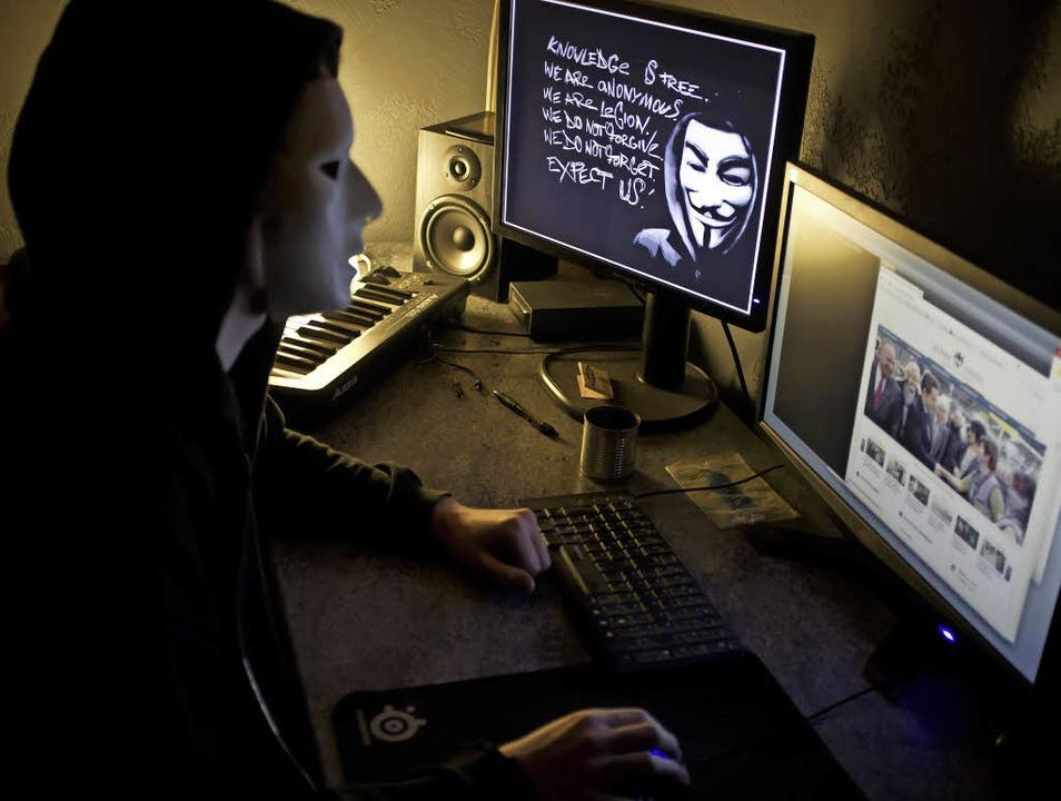 Maskierter Anonymous-Hacker  | Foto: AFP