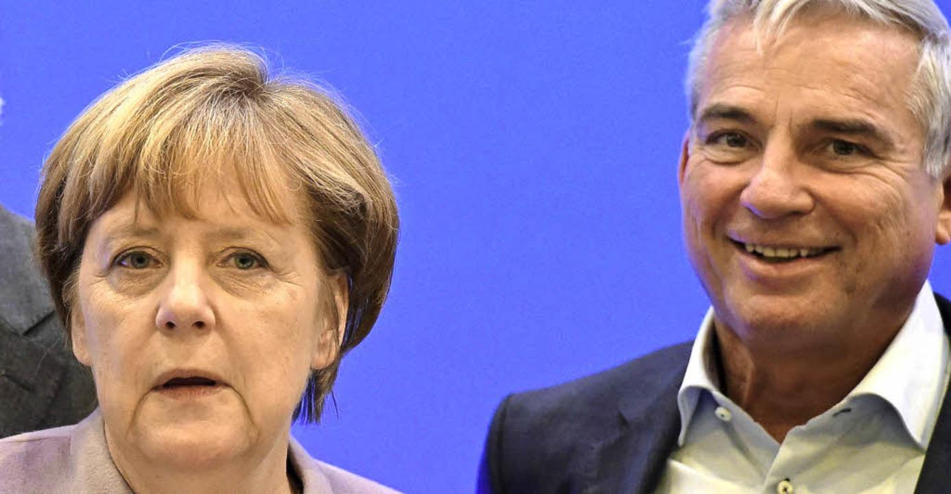 Angela Merkel und Thomas Strobl  auf dem Parteitag in Essen   | Foto: afp