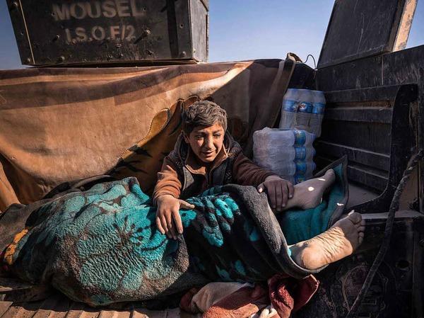 """Zweiter Preis """"General News, Stories"""" für Fotograf Sergey Ponomarev: Ein Junge weint im November 2016 um seinen vom IS getöteten Vater."""