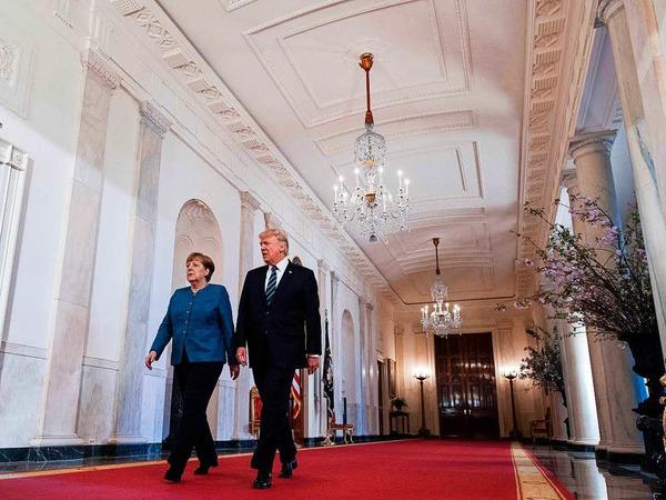 Fotos vom ersten Treffen zwischen Donald Trump und Angela Merkel.