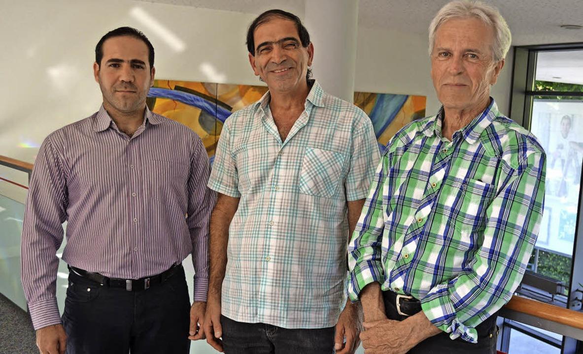 Nehmen positive Erfahrungen aus dem Mä... Jabur und Maurhf Alzabi (von rechts).  | Foto: Nikola Vogt