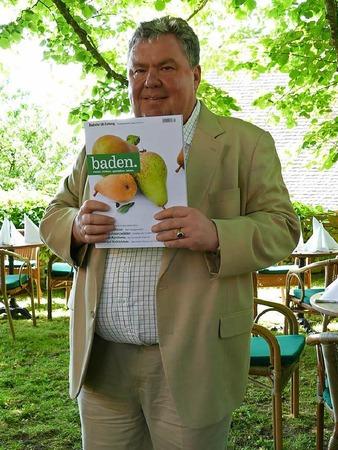Christian Hodeige mit der neuen Ausgabe von baden.