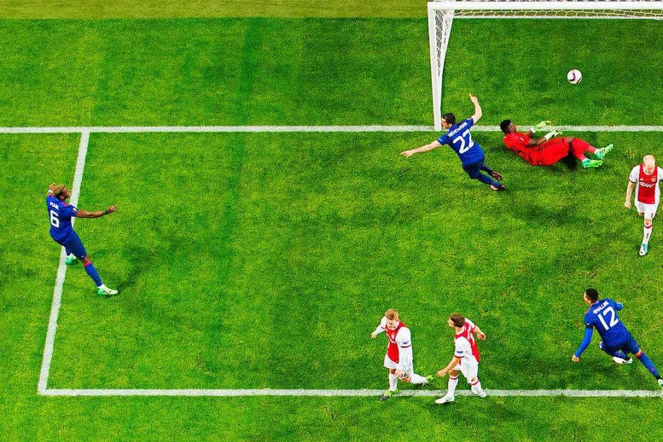 Henrich Mchitarjan erzielt das entscheidende 2:0. (Foto: dpa)