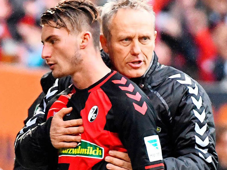 SC-Trainer Christian Streich (rechts) hätte Philipp gerne behalten.  | Foto: dpa