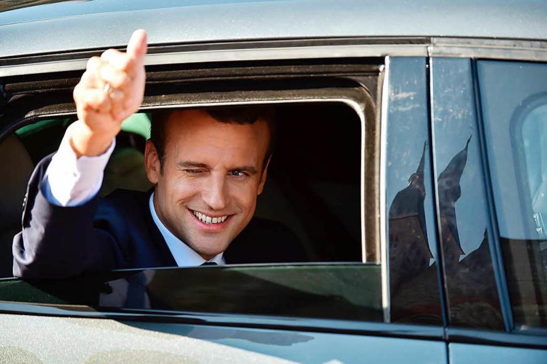 Emmanuel Macron ist mit seiner Partei ...Doch es bleibt ein fader Beigeschmack.  | Foto: AFP