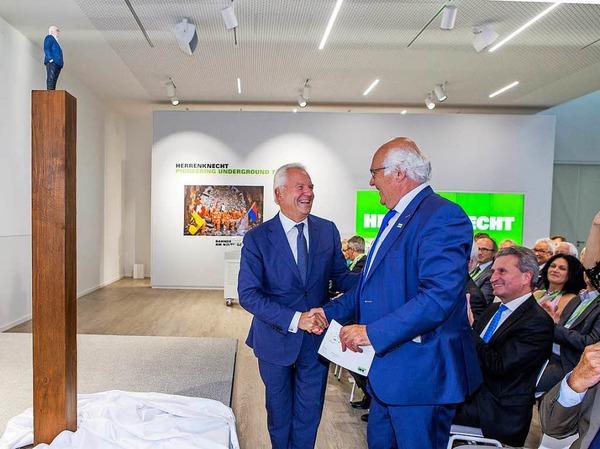 Rüdiger Grube gratuliert Martin Herrenknecht