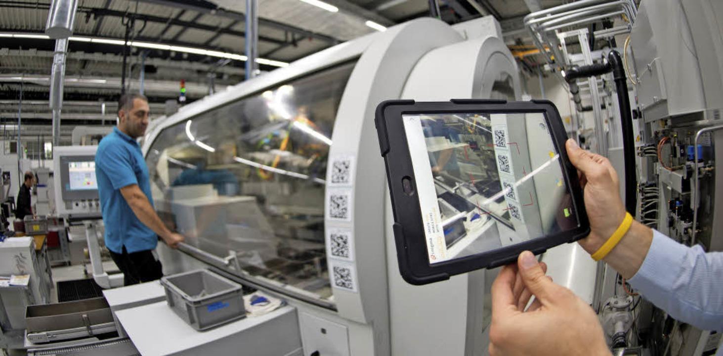 Auch das ist Industrie 4.0: Informatio...ttel, sondern digital weitergegeben.    | Foto: Bernd Weissbrod/dpa