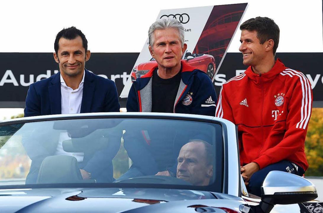 Unter Jupp heynckes (links) hat Thomas Müller wieder gut Lachen.  | Foto: AFP