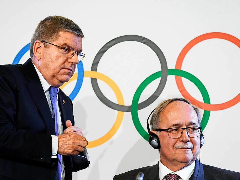 Thomas Bach (links) und Samuel Schmid  | Foto: AFP