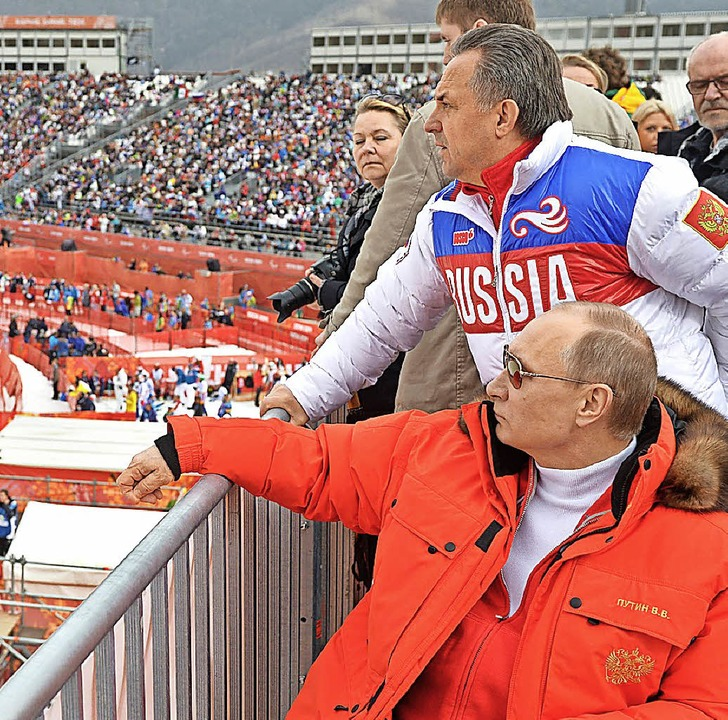 Der russische Präsident Wladimir Putin...o bei den Paralympics 2014 in Sotschi.  | Foto: dpa