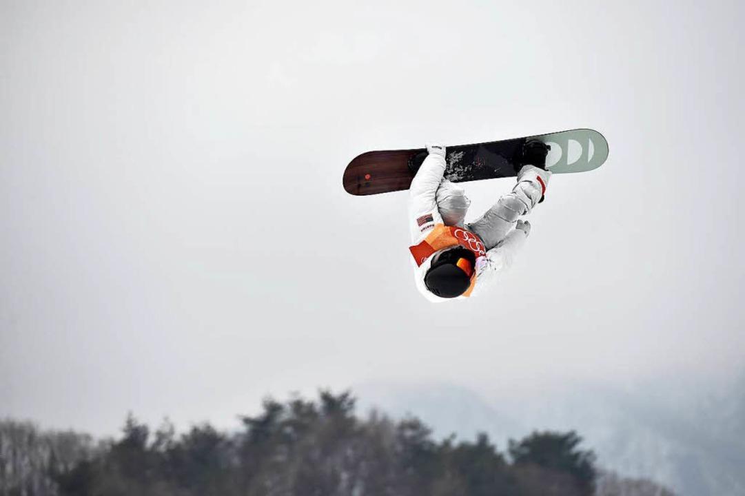 Mit einem Traumlauf hat Snowboard-Supe... Halfpipe nach 2006 und 2010 gefeiert.  | Foto: dpa