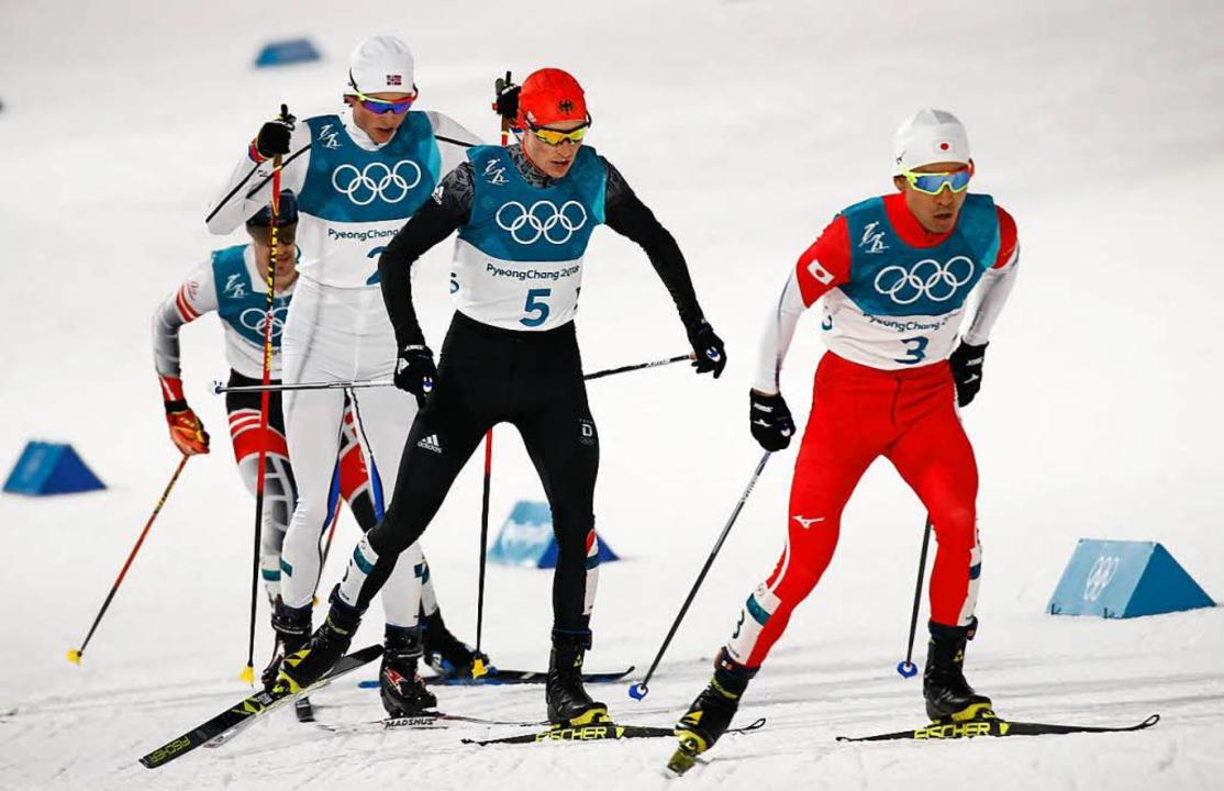 Eric Frenzel (Nr. 5) läuft zu Gold  | Foto: AFP