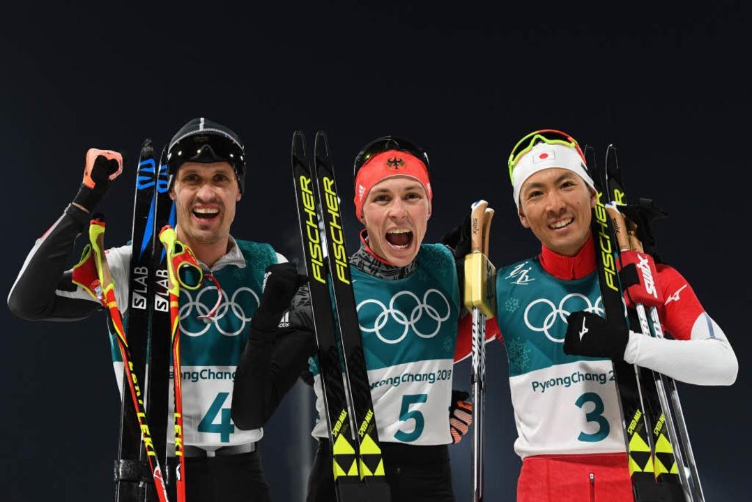 Bronzemedaillengewinner Lukas Klapfer (von links), Eric Frenzel und Akito Watabe  | Foto: AFP