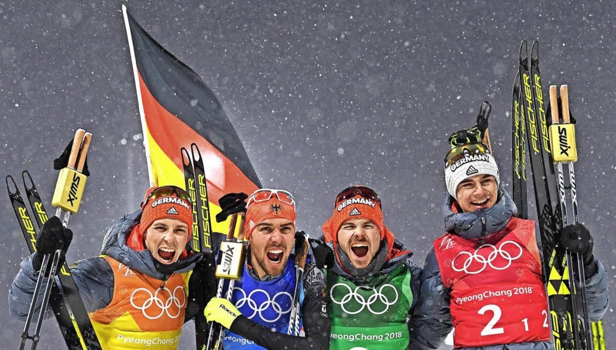 Im Team nicht zu schlagen (von links):...nz Geiger bei ihrem Sieg in Südkorea    | Foto: AFP