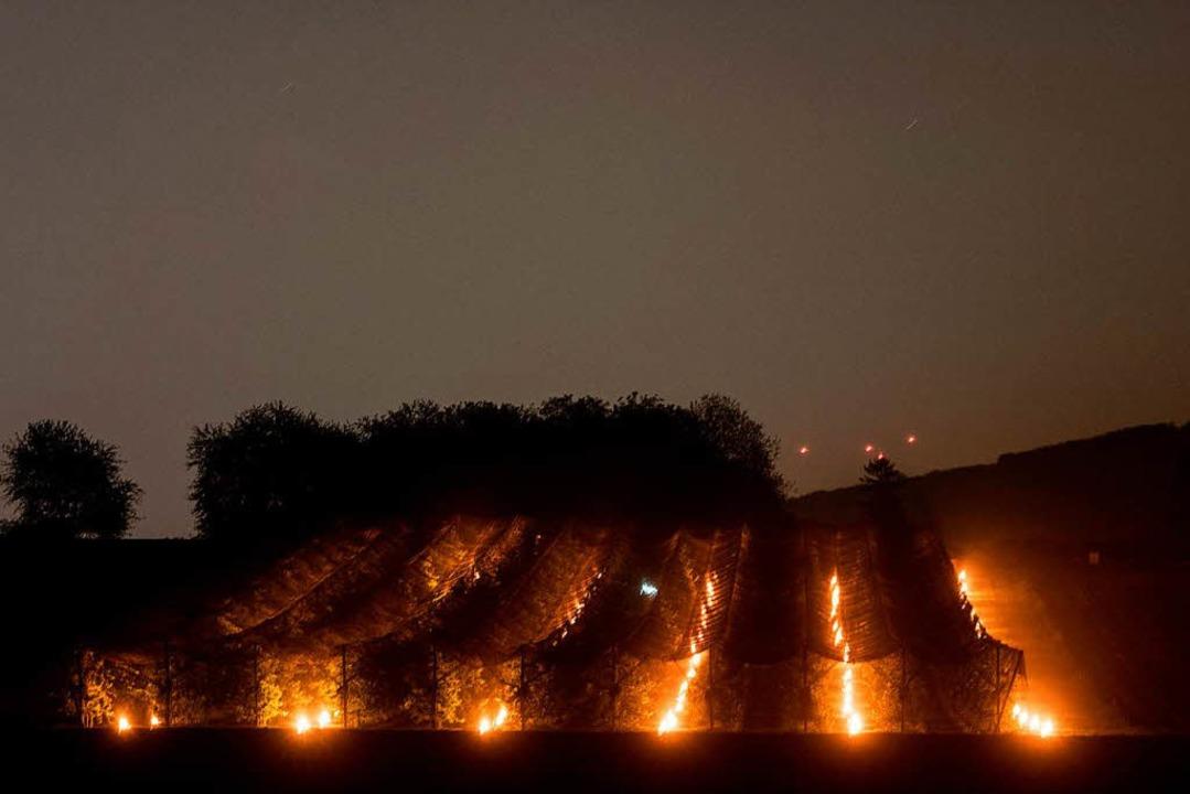 2017 arbeitete Joel Siegel mit riesigen Kerzen gegen den Frost an.    Foto: dpa