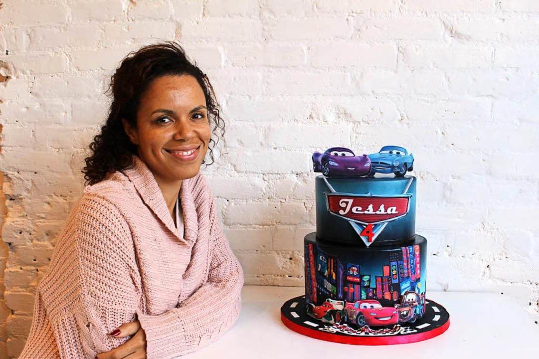 Konditorin Miriam Milord aus Deutschla...o Woche 20 bis 35 ausgefallene Kuchen.  | Foto: dpa