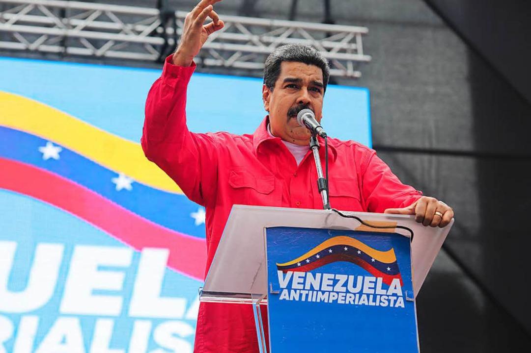 """Nicolas Maduro, Präsident von Venezuel...alistischen"""" Marsches in Caracas.    Foto: dpa"""