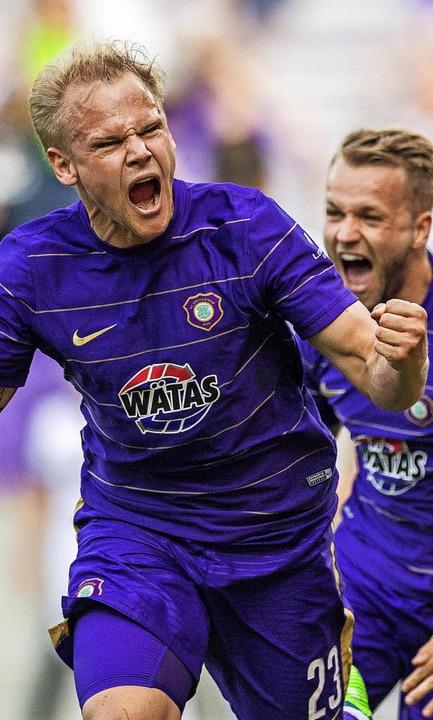 Drei Tore für den Ligaverbleib: Sören ...e weiter in der zweiten Liga bleibt.      Foto: dpa