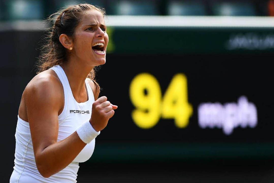Julia Görges wirkt gelöst bei ihrem Auftritt in Wimbledon.  | Foto: AFP