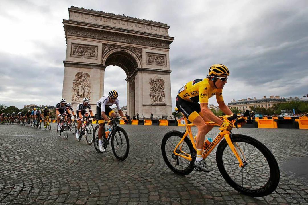 Geraint Thomas mit dem gelben Trikot in Paris  | Foto: dpa