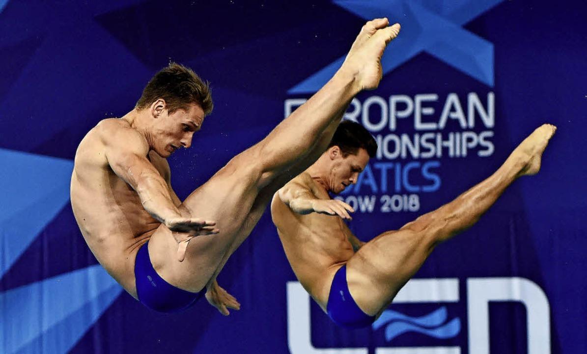 Synchron zu Bronze bei der Europameist... Rüdiger (links) und Patrick Hausding   | Foto: dpa