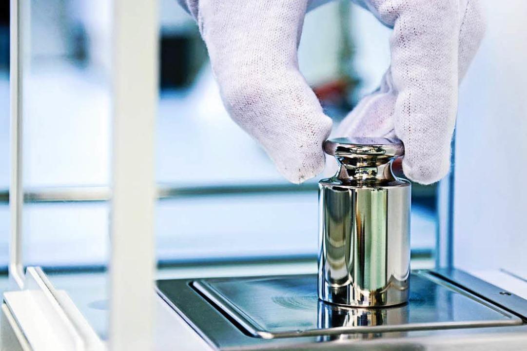 Eichgewicht zum Kalibrieren einer Waage  | Foto: stock.adobe.com