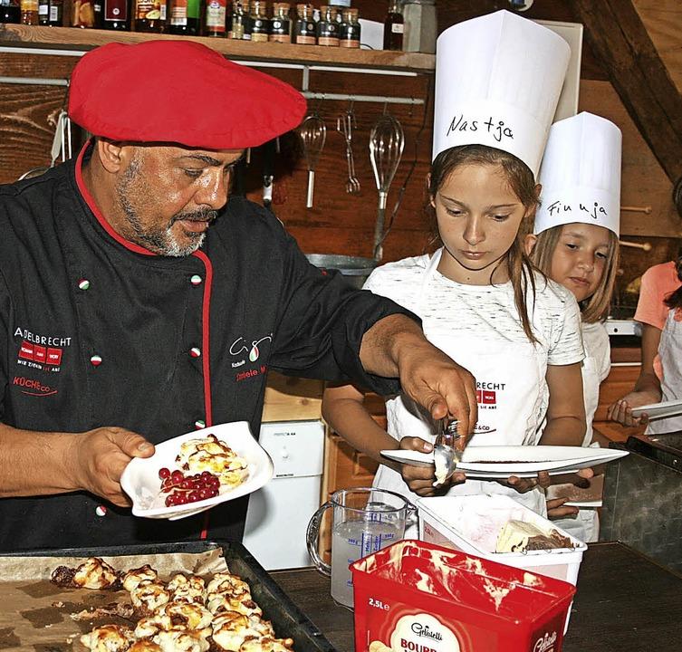 Kochen und Essen mit Daniele Maula in ...im Maulburger Ferienspaß-Programm.      | Foto: Ralph Lacher