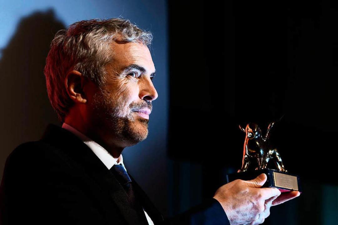 Alfonso Cuarón mit seinem Preis  | Foto: AFP