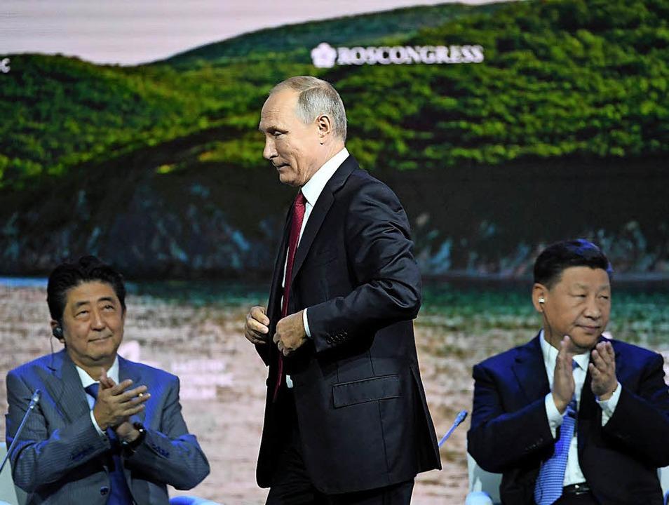 Chinas Präsident Xi Jinping (rechts), ...der russische Präsident Wladimir Putin  | Foto: AFP