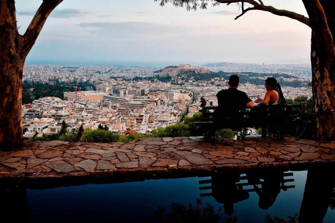 Welch ein Ausblick – der Panoram...er Athen lockt nicht nur Touristen an.  | Foto: LOUISA GOULIAMAKI
