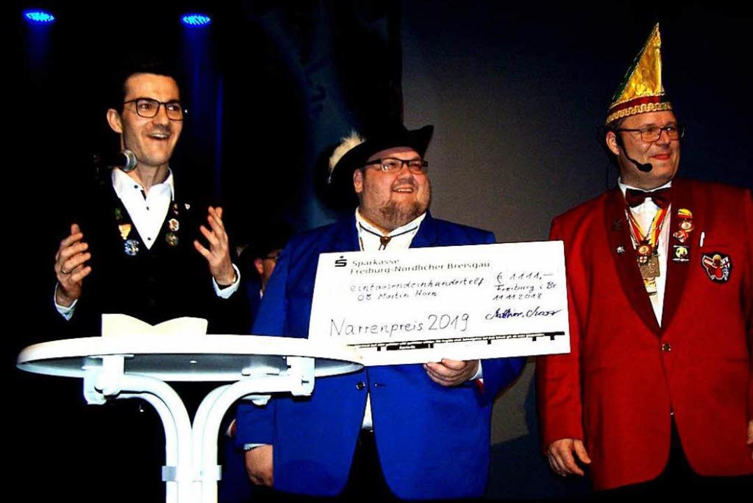 OB Martin Horn wurde von Matthias Mose...s der Freiburger Narren ausgezeichnet.  | Foto: Hans Sigmund