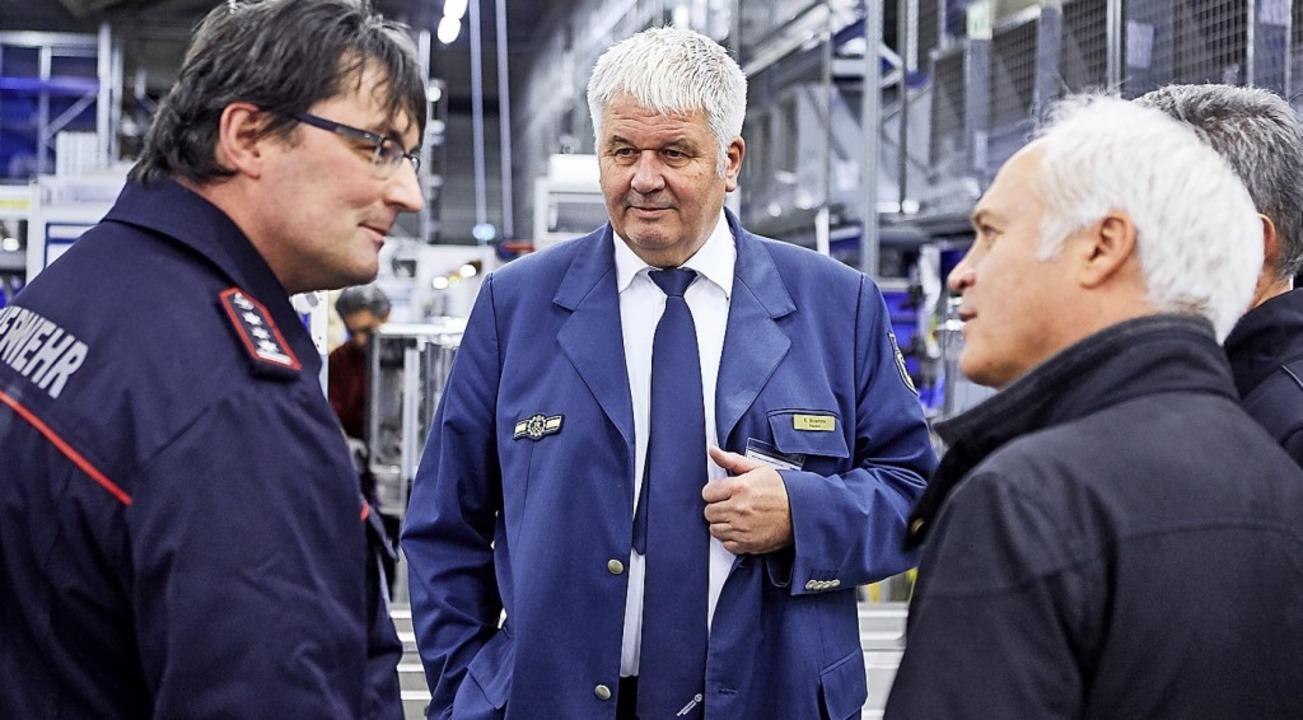 THW-Präsident  Broemme (M.) zu Gast bei Meiko.   | Foto: Markus Dietze