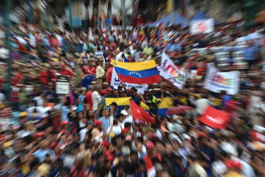 Die Unterstützer der Opposition feiern den Aufstand.  | Foto: AFP